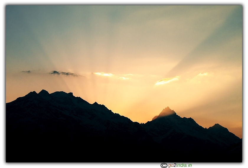 Sun rays gushing out from peaks