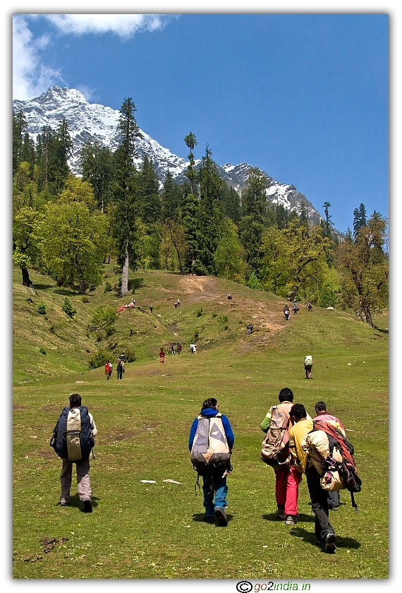 People carrying paragliding material to hill peak at Solang valley of Manali
